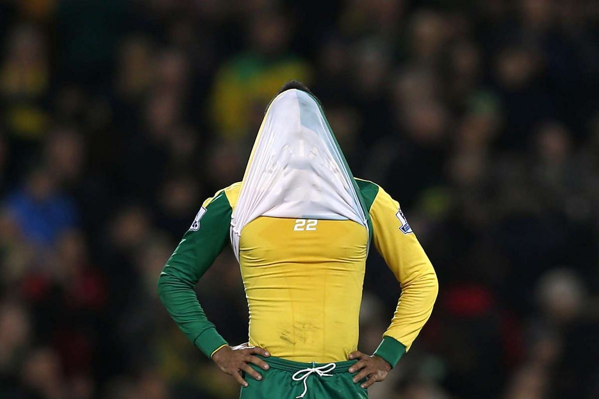 Norwich City's Nathan Redmond looks dejected after a game during the English Premier League football match with Chelsea.