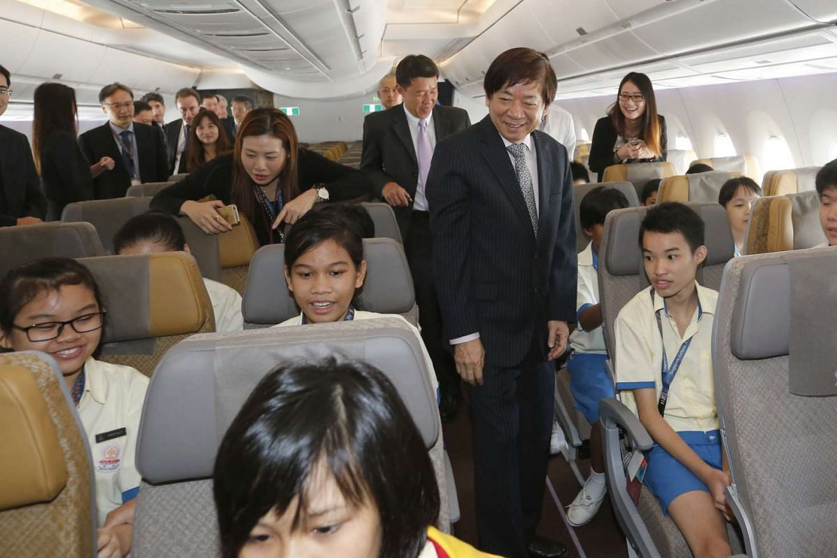 Transport Minister Khaw Boon Wan mingling with invited students inside the A350.