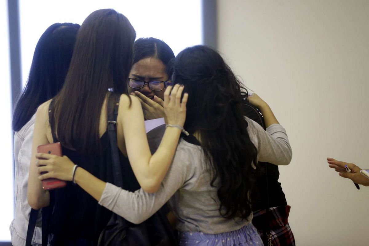 Students react after receiving their A-level results at Millennia Institute on March 4, 2016.
