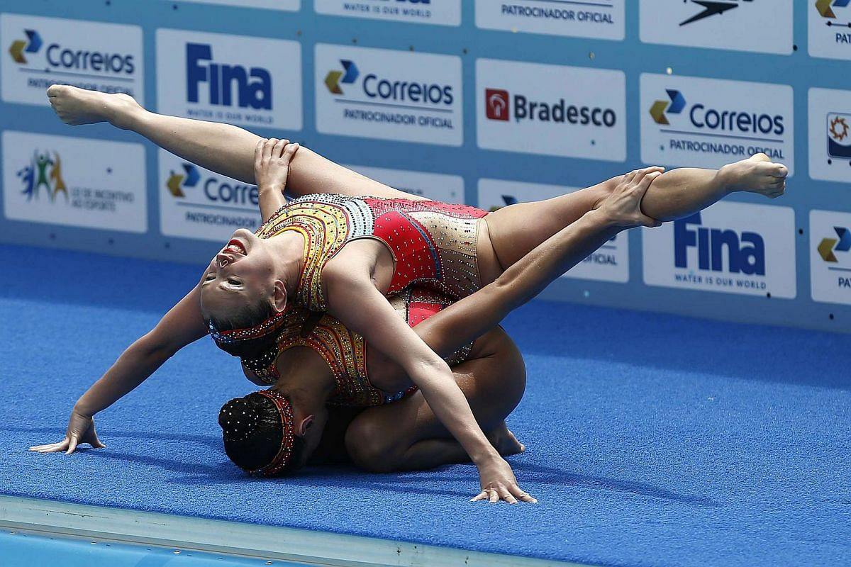 French Margaux Chretien and Laura Auge perform during the Duet First Round Free Routine in Rio de Janeiro, on March 3, 2016.