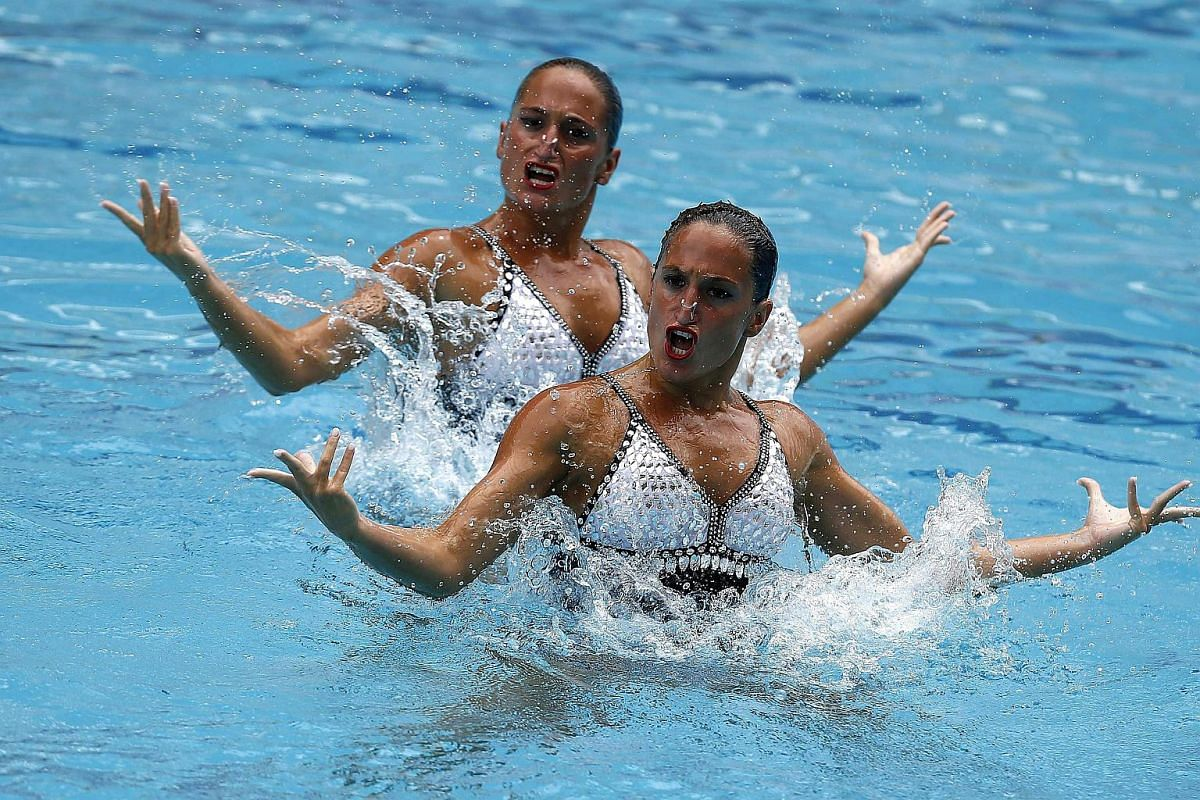 Argentina's Etel Sanchez and Sofia Sanchez perform during the Duet First Round Free Routine in Rio de Janeiro, on March 3, 2016.