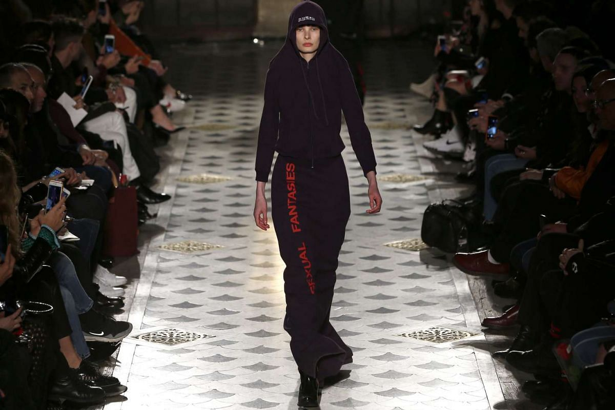A model presents a creation from the Fall/Winter 2016/17 collection by Vetements fashion house, on March 3, 2016.