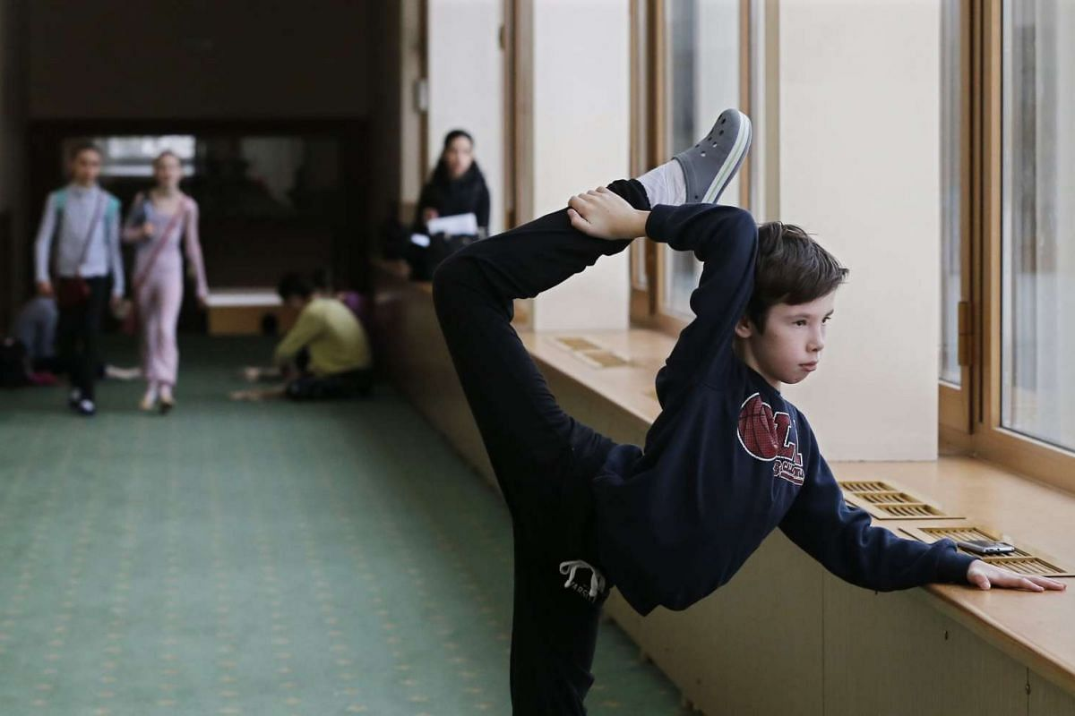 A student warms up in the hallway at Moscow State Academy of Choreography in Moscow, on March 3, 2016.