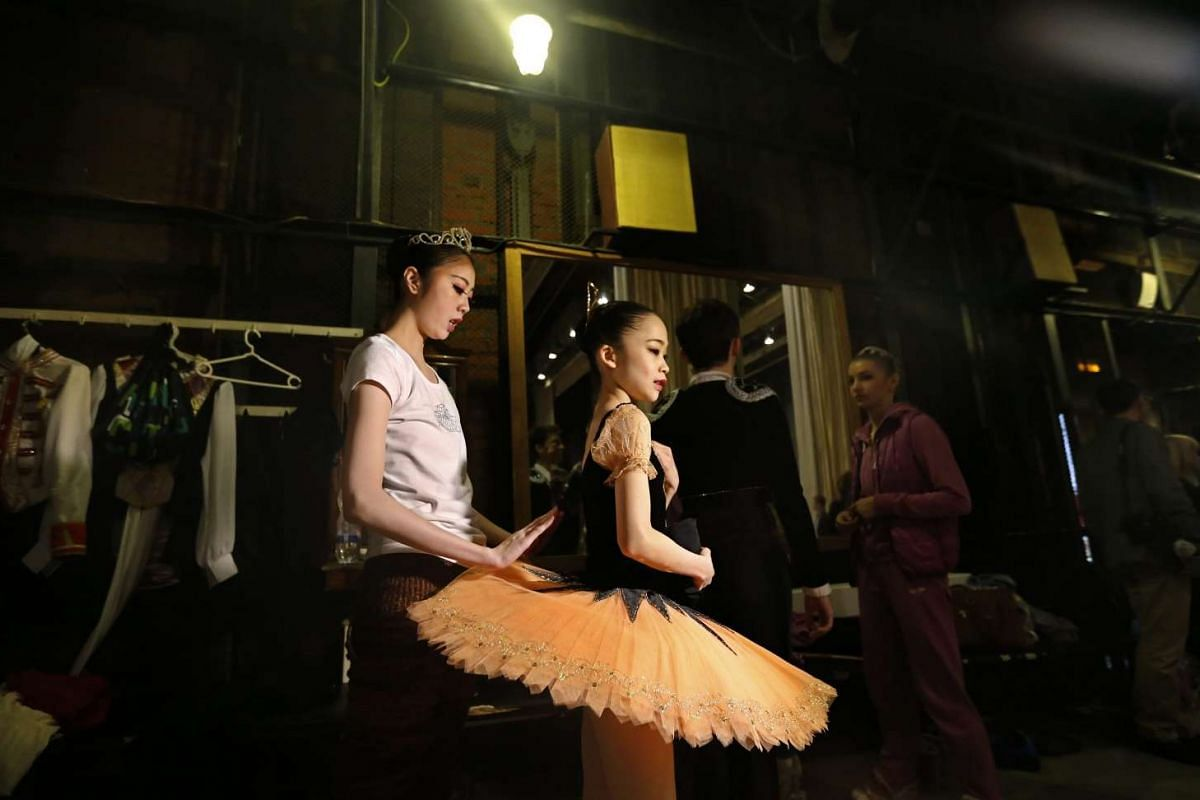 Students wait at the backstage at Moscow State Academy of Choreography in Moscow, on March 3, 2016.