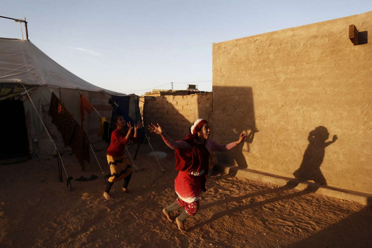 Indigenous Sahrawi girls playing near their tent in the Al Smara refugee camp in Algeria on March 2, 2016.