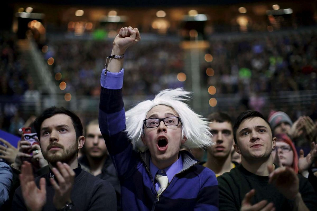 Supporters cheering at a campaign rally for US Democratic presidential candidate Bernie Sanders in East Lansing, Michigan, on March 2, 2016.
