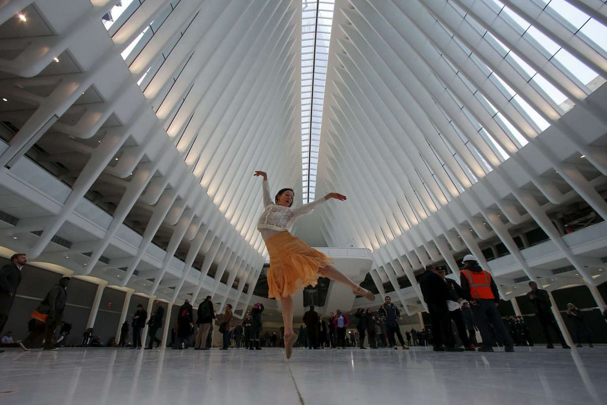 Dancer Laura Rae Bernasconi strikes a pose at the World Trade Center Oculus transportation hub in New York, on March 3, 2016.