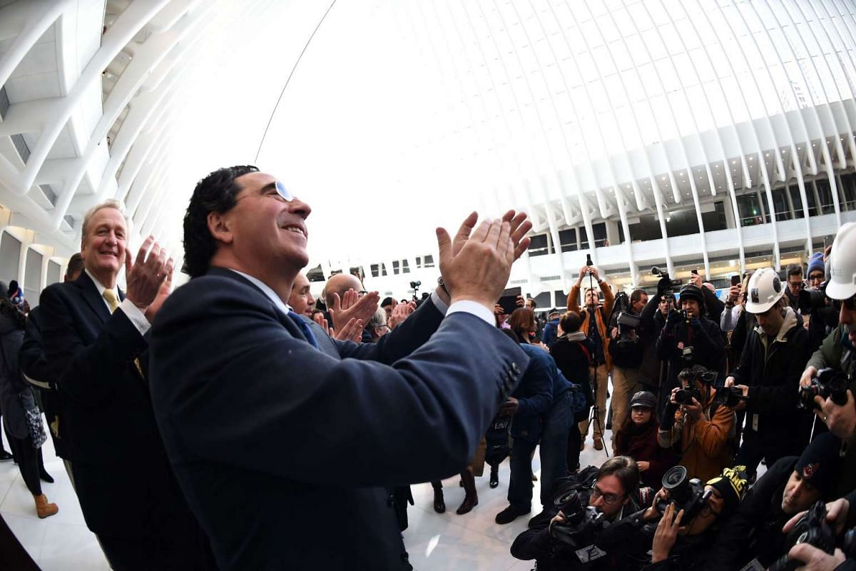 Architect Santiago Calatrava claps as his World Trade Center Transportation Hub, known as the Oculus, on March 3, 2016.
