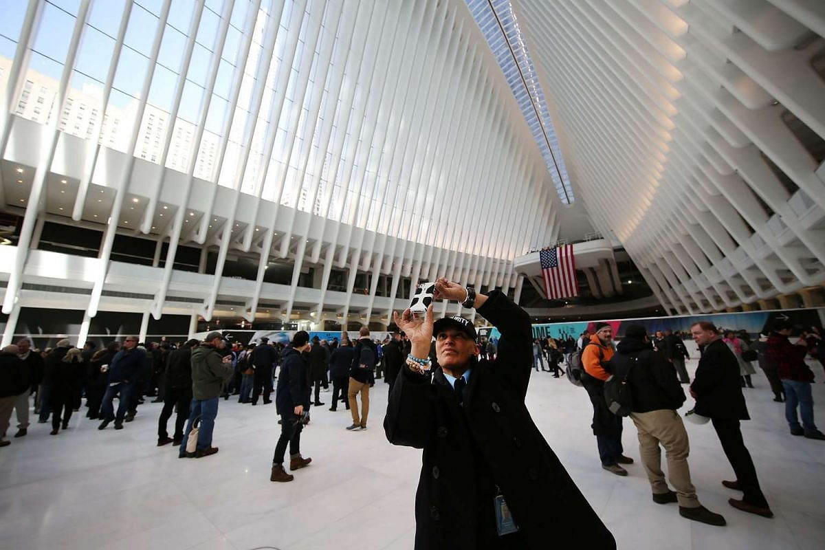 People walk through the new partially opened World Trade Center Transportation Hub after nearly 12 years of construction, on March 3, 2016.