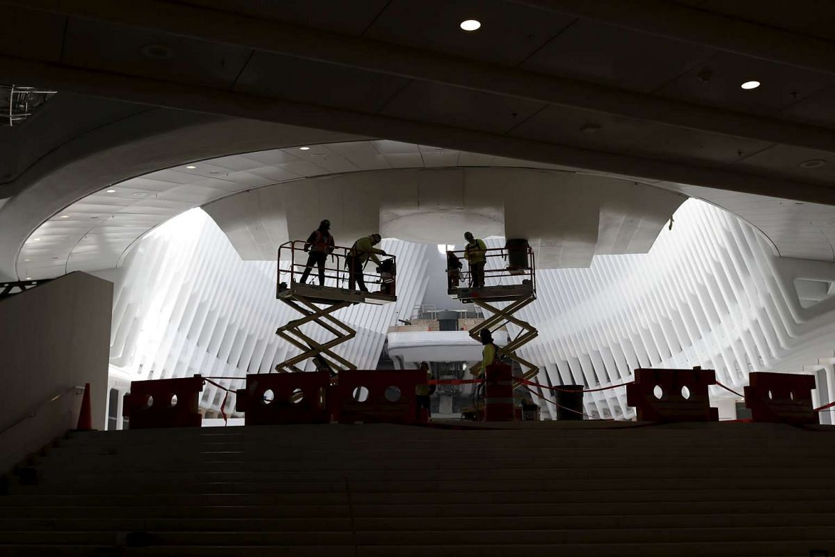 Workers are seen in the interior of the Oculus structure of the World Trade Center Transportation Hub, on March 1, 2016.