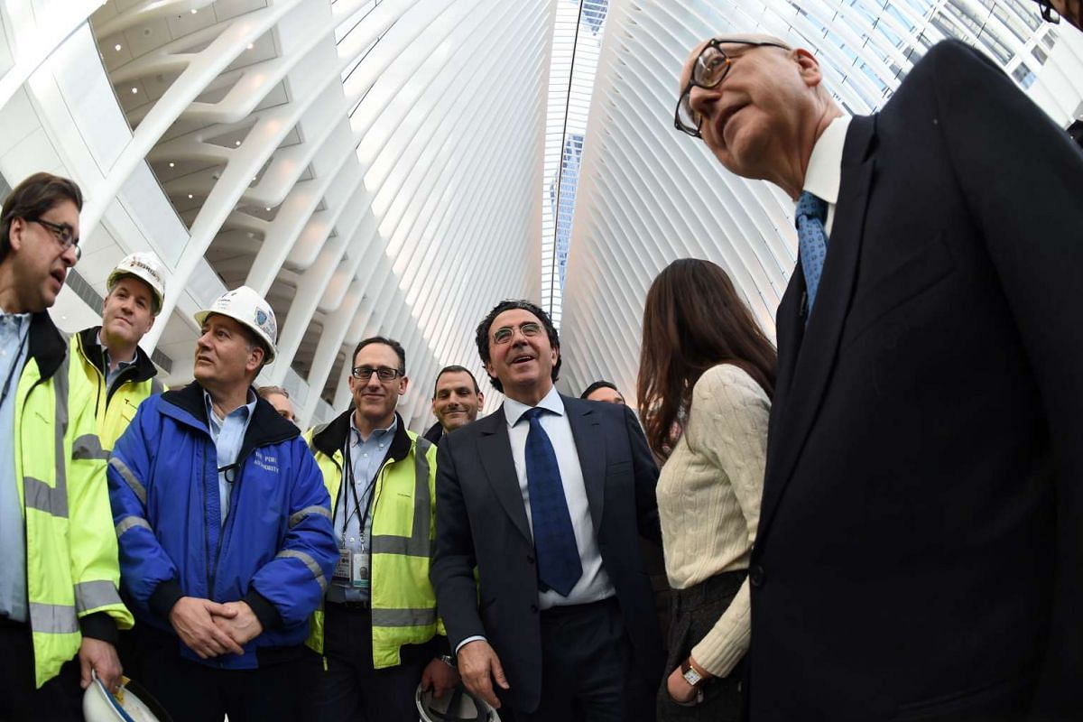 Spanish architect Santiago Calatrava (centre) attends the opening of his World Trade Center Transportation Hub, on March 3, 2016.