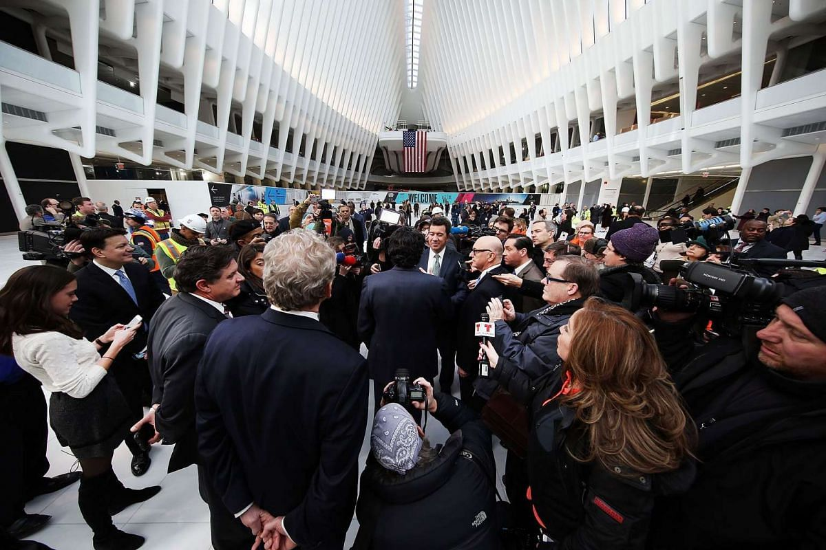 Media attend a presser in the new partially opened World Trade Center Transportation Hub after nearly 12 years of construction, on March 3, 2016.