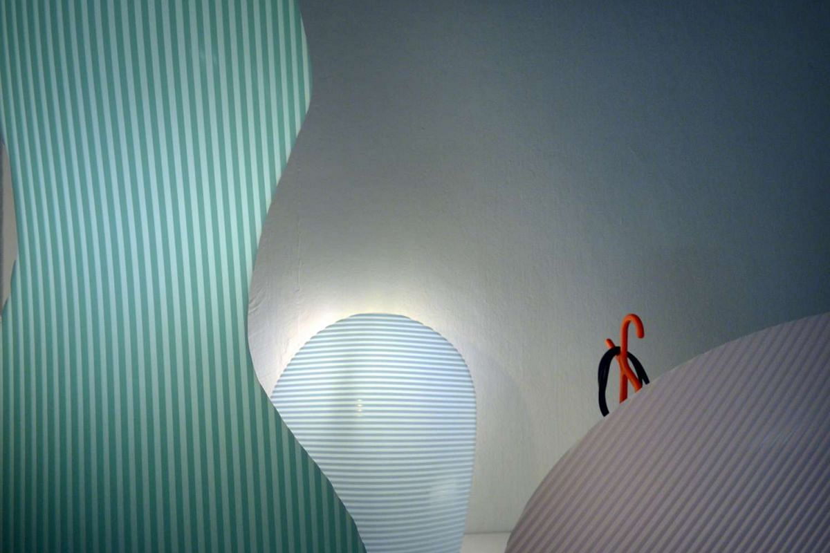 Studio Juju has created a curvy light out the solid surface material.
