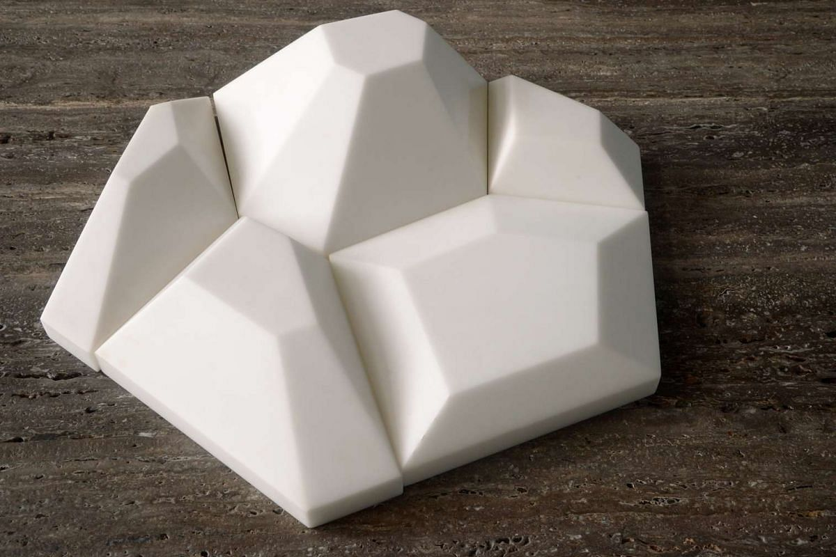 Park + Associates designers have created a solid surface honeycomb-like product that can be used on building facades.