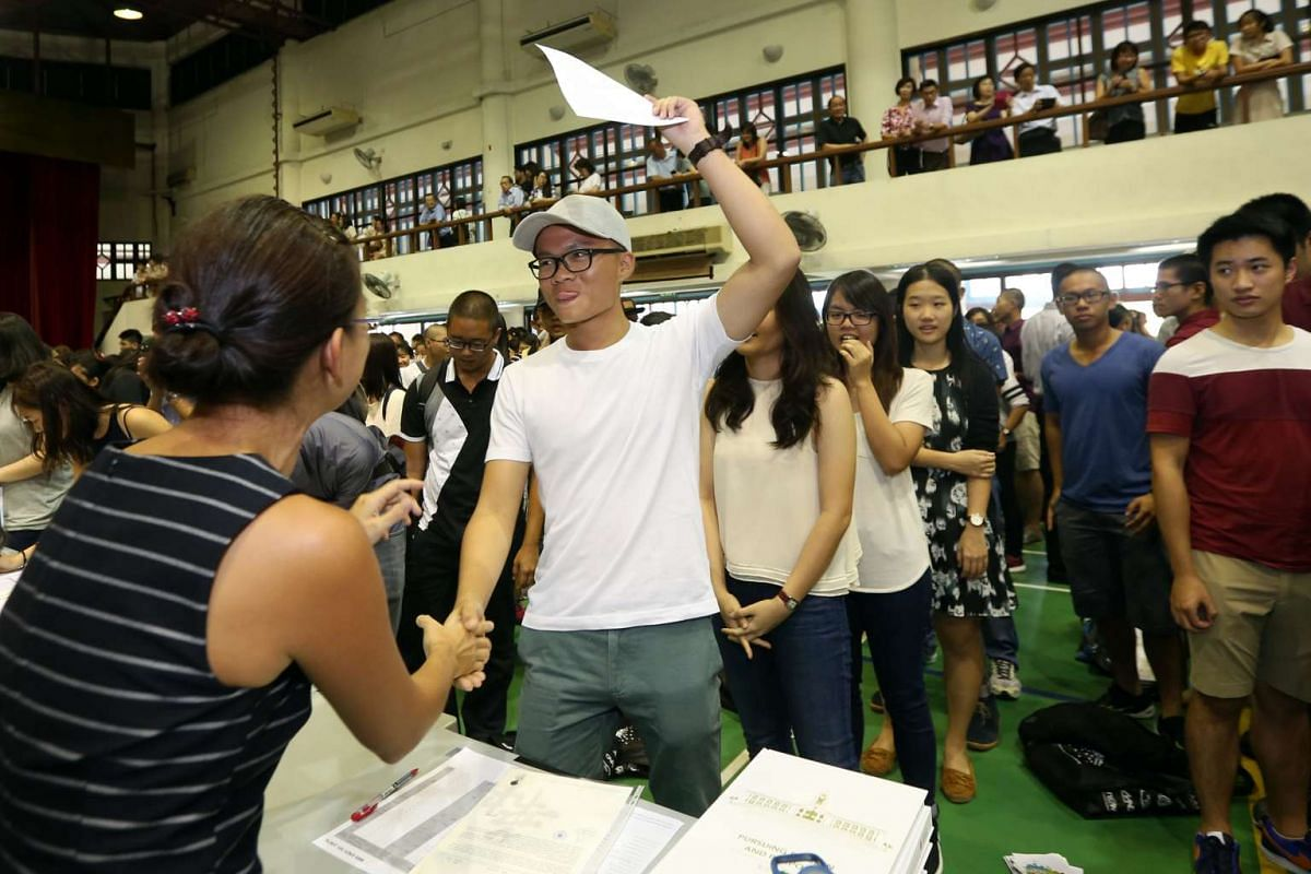 Mr Chua Chiah Soon reacts after receiving his results in Hwa Chong Institution on March 4, 2016.