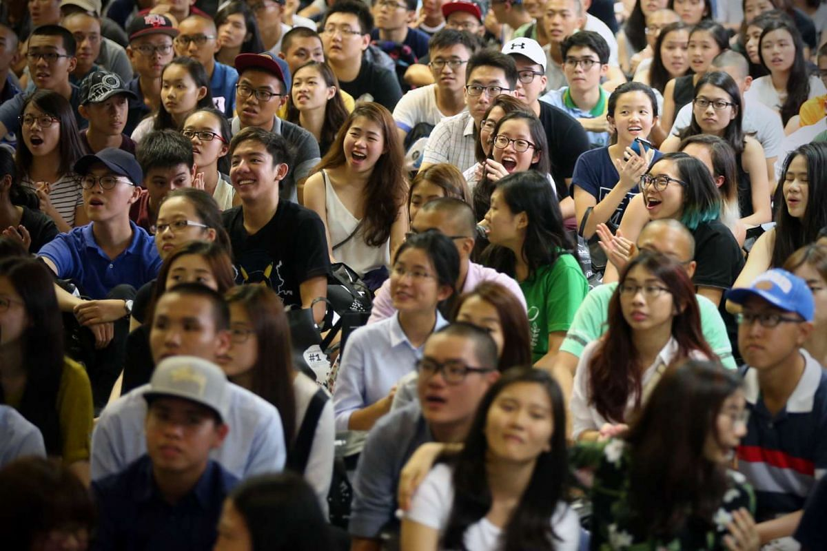 Hwa Chong Institution students react during the principal's address on March 4, 2016.