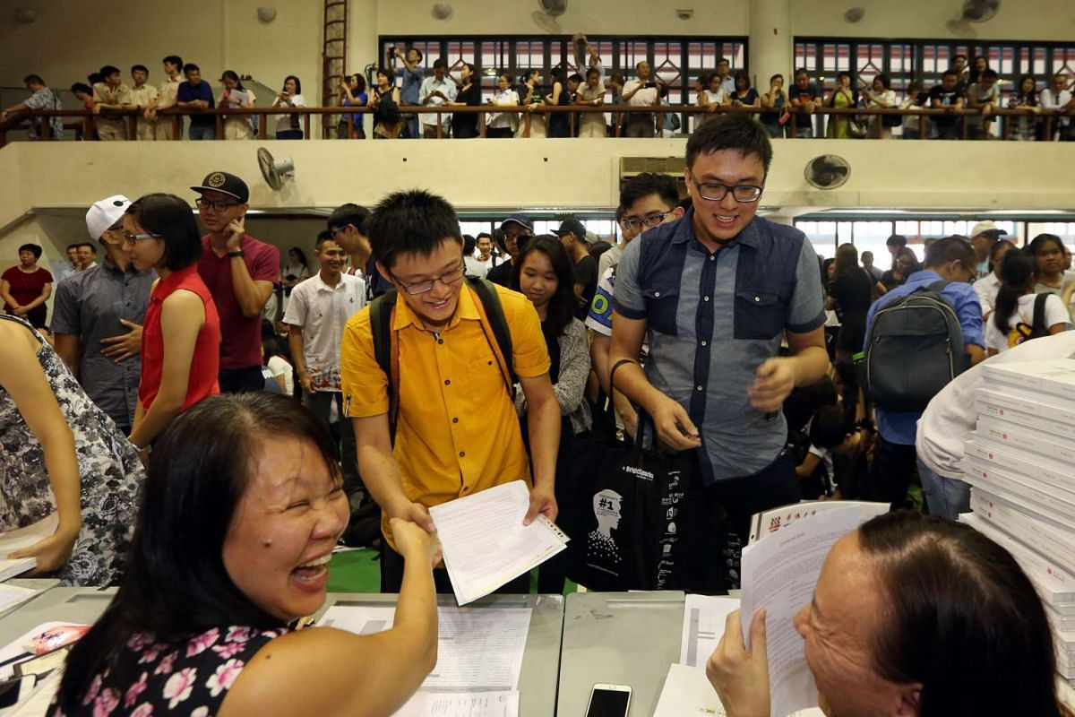Hwa Chong Institution students collect their GCE A-Level results in the school hall on March 4, 2016.