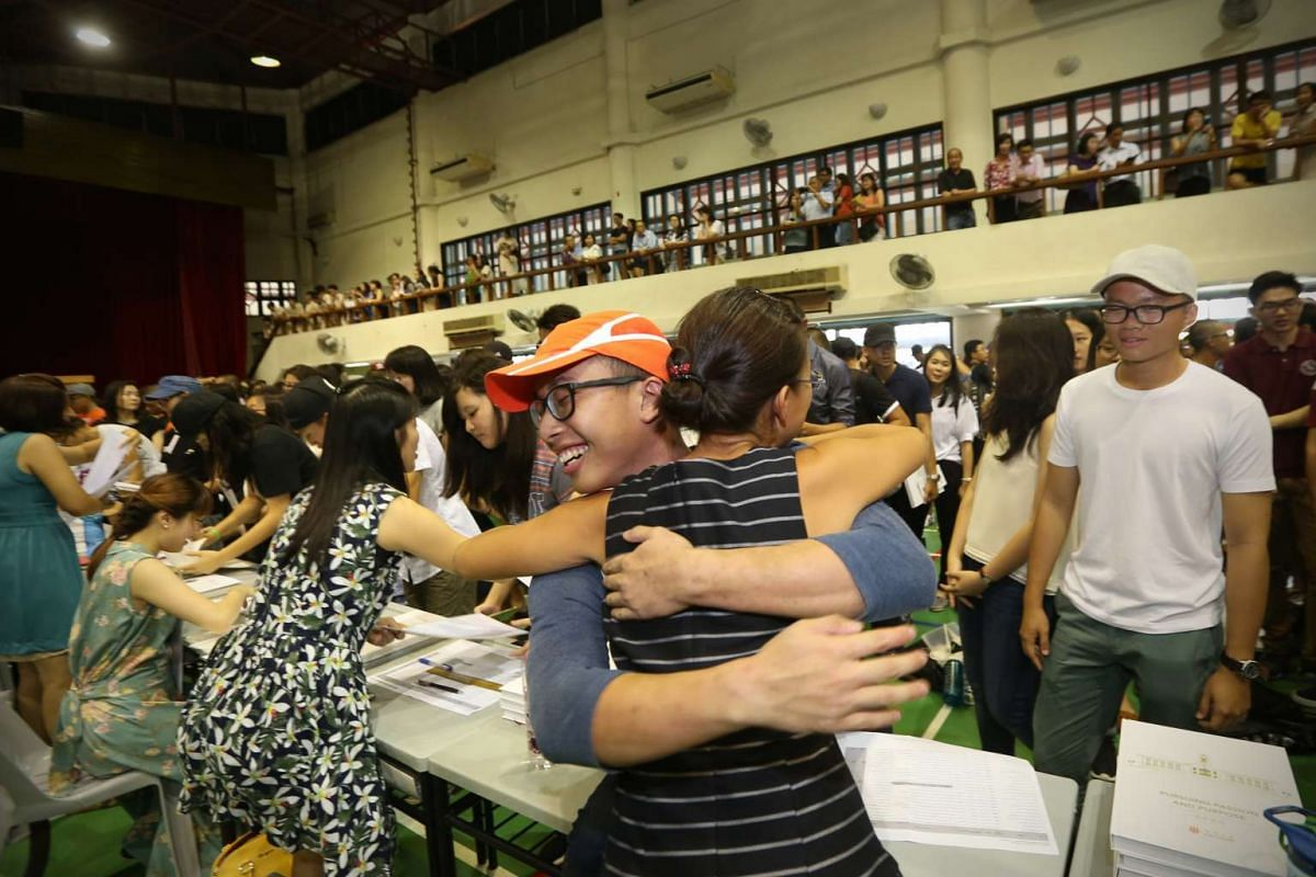 Mr Jerryl Goh hugs his civics tutor Mrs Cindy Tay after receiving his results in Hwa Chong Institution on March 4, 2016.