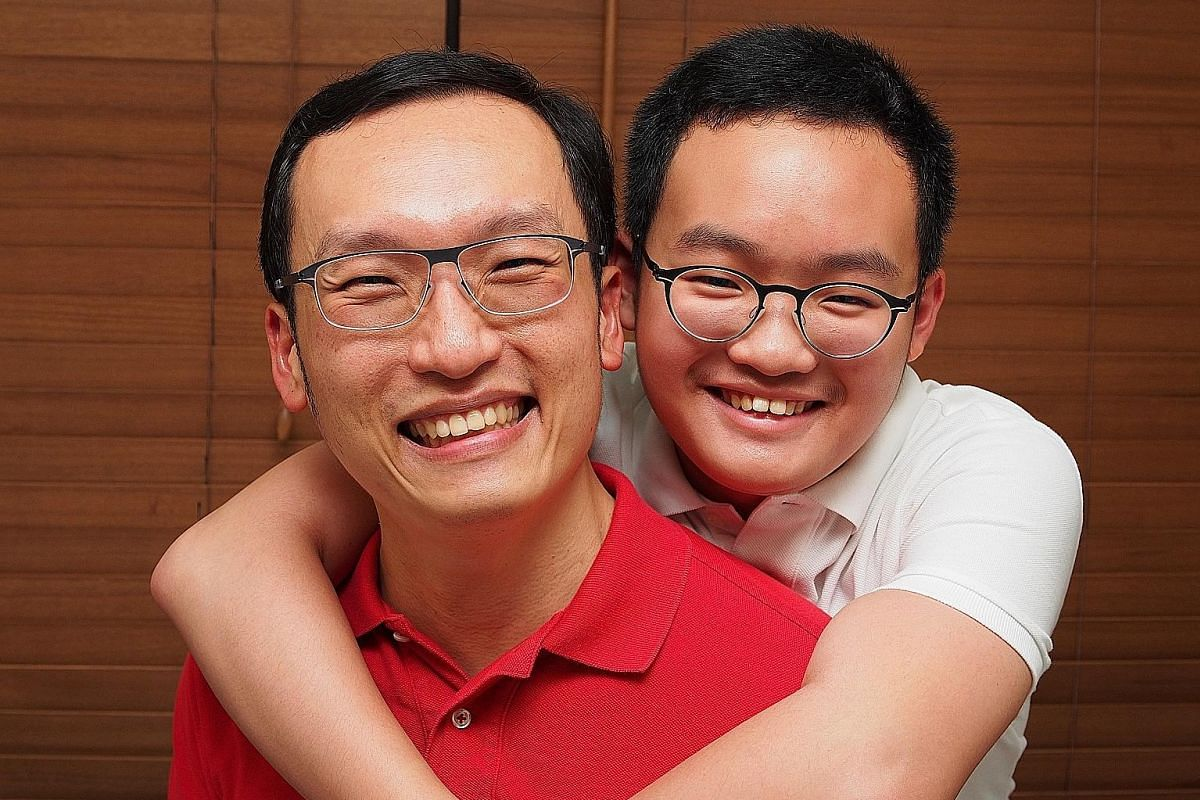 Lendlease's deputy fund manager Joey Gabbani spent a day of well-being leave last year with sons Luca (right) and Marco (far right). OCBC Bank's head of customer insights Ken Wong carried forward nine days of leave from 2014 to spend with his son for