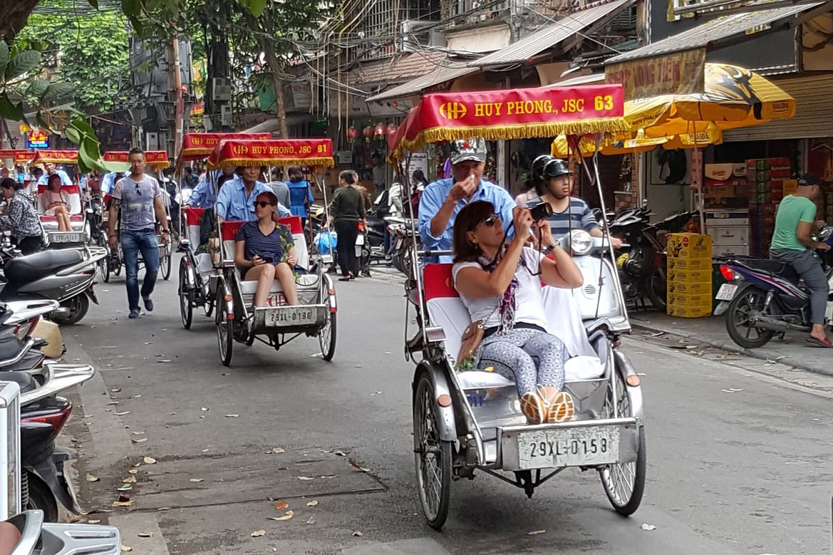 Pedal-powered pedicabs are seen everywhere in the city's Old Quarter.