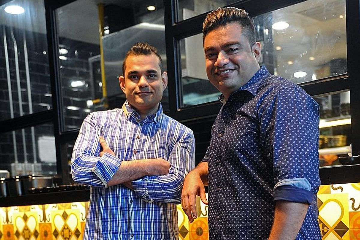 Spize bosses Haresh (left) and Anil Sabnani rebranded their restaurants, opting for walls with murals and bold orange and black tiling.