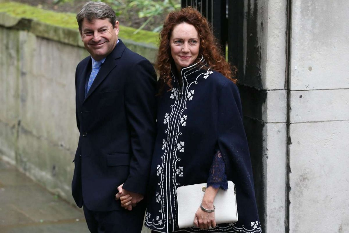 Chief executive of News UK Rebekah Brooks (right) and her husband Charlie posing for a photograph as they arrive at St Bride's Church in central London on March 5, 2016, to attend a ceremony to celebrate the marriage of media magnate Rupert Murdoch a