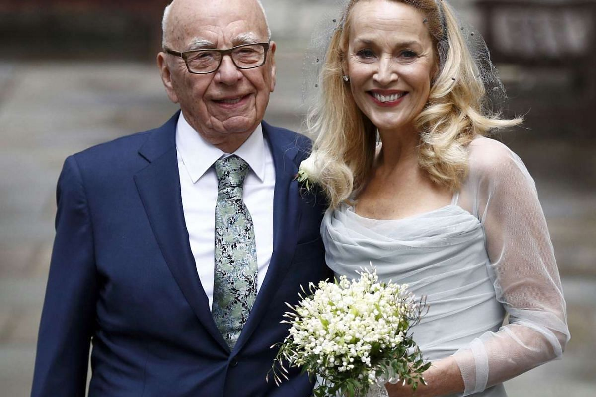 Media Mogul Rupert Murdoch and former supermodel Jerry Hall posing for a photograph outside St Bride's Church following a service to celebrate their wedding on Saturday (March 5) in London.