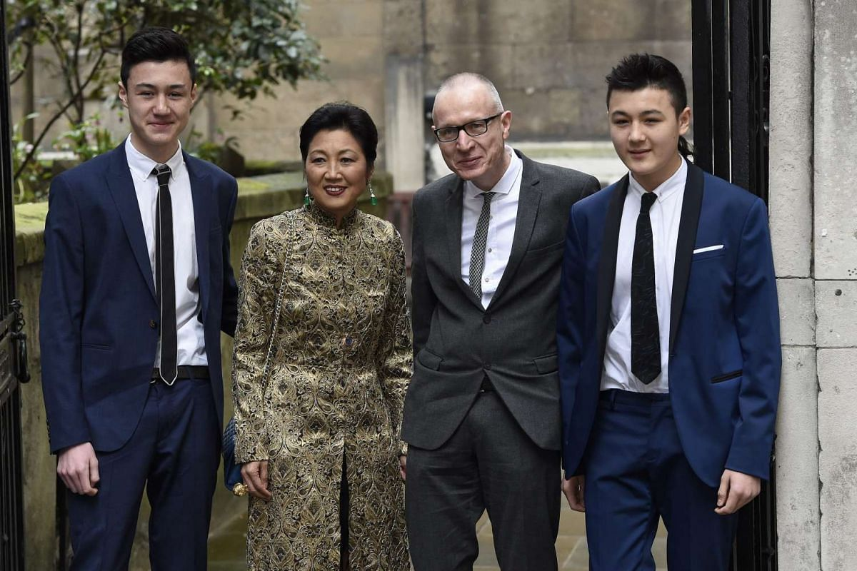 Chief executive of News Corp Robert Thomson (second, right) and family arriving at St Bride's Church for a service to celebrate the wedding of media mogul Rupert Murdoch and former US model Jerry Hall in London, Britain, on March 5, 2016.