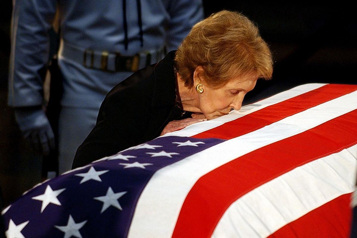 Former First Lady Nancy Reagan kissing the casket containing the remains of her husband, former US President Ronald Reagan, at the Capitol rotunda in Washington, DC.