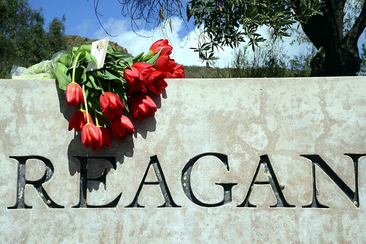 A bouquet of flowers is placed outside the Ronald Reagan Presidential Library as people pay their respects to former First Lady Nancy Reagan.