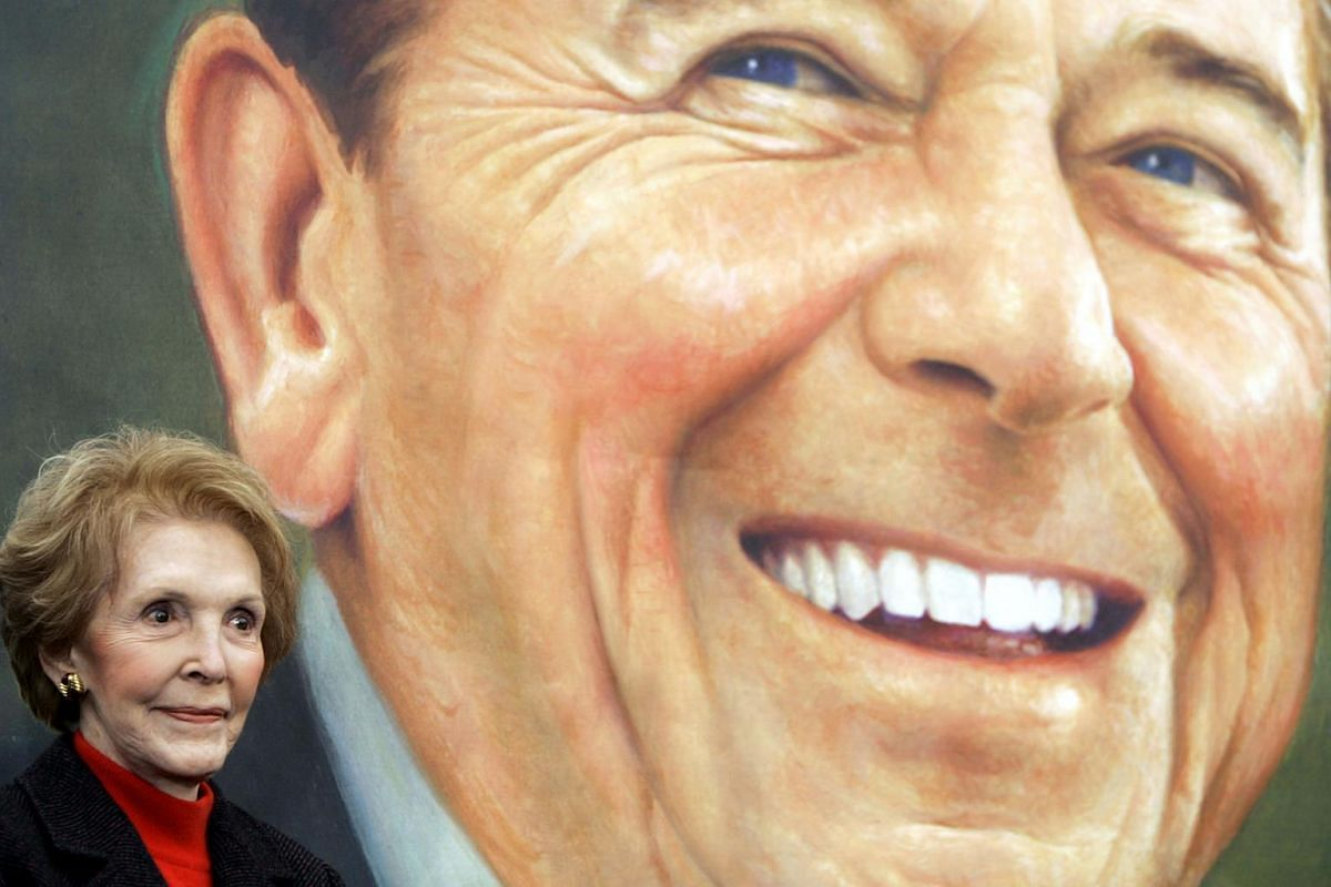 Former First Lady Nancy Reagan stands next to to an image of the President Ronald Reagan commemorative postage stamp during a ceremony at the Ronald Reagan Presidential Library and Museum.