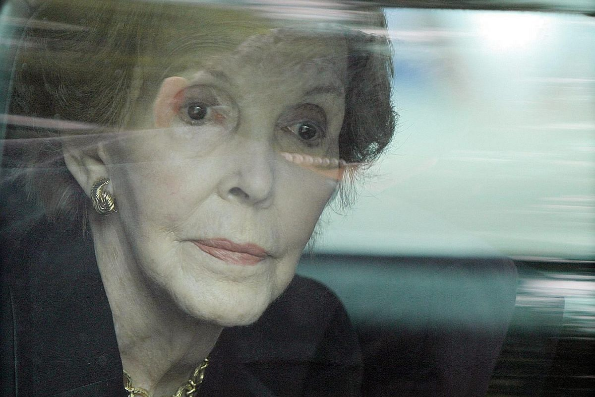 Former First Lady Nancy Reagan looking out of the window of her limousine as she follows the motorcade bearing the coffin of her late husband, former US President Ronald Reagan, in Washington, DC.