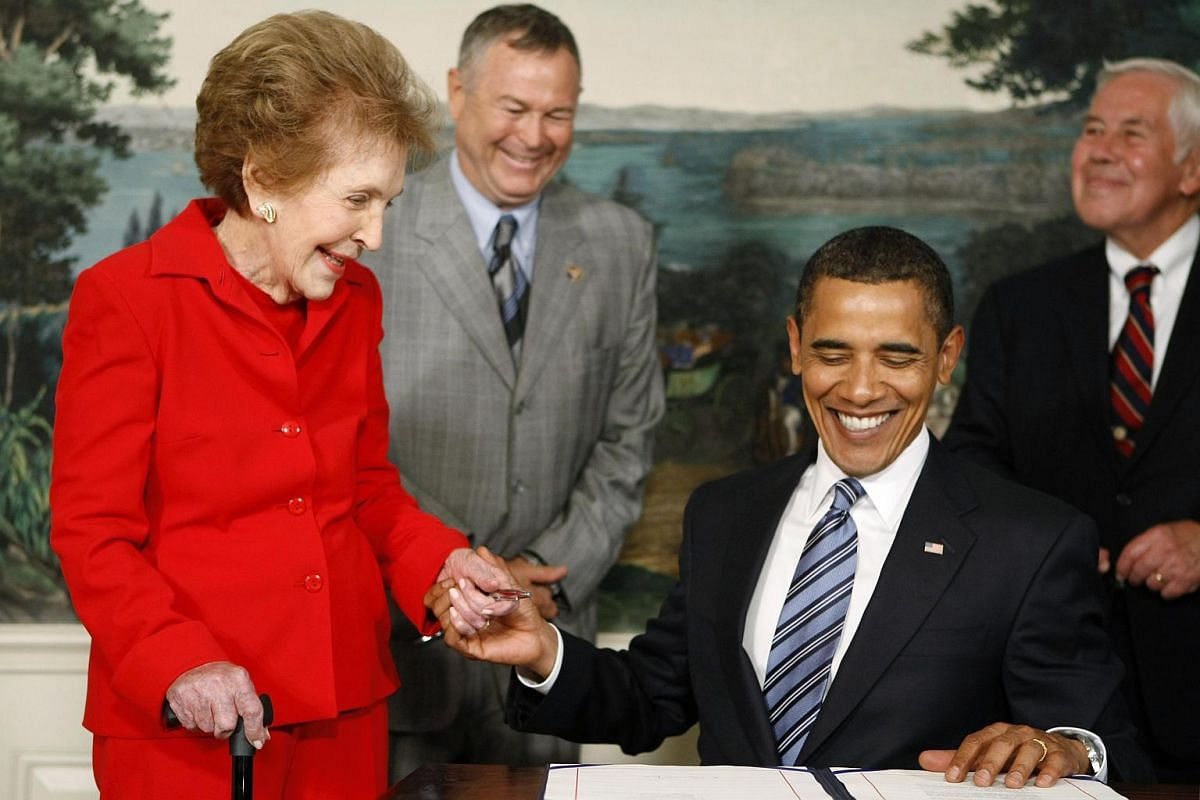 US President Barack Obama with former first Lldy Nancy Reagan after signing the Ronald Reagan Centennial Commission Act at the White House on June 2, 2009.