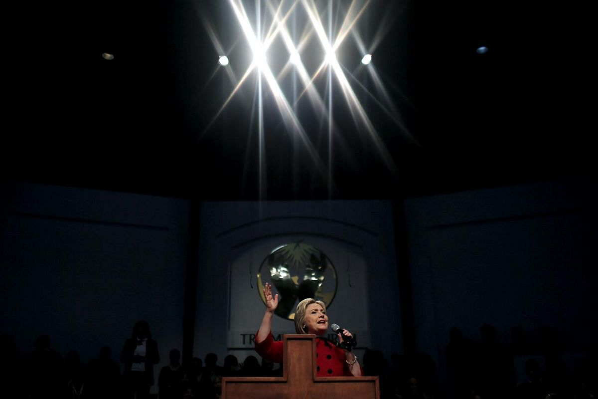 US Democratic presidential candidate Hillary Clinton speaks at a mass at the Triumph Church during a campaign stop in Detroit, Michigan, on March 6, 2016.