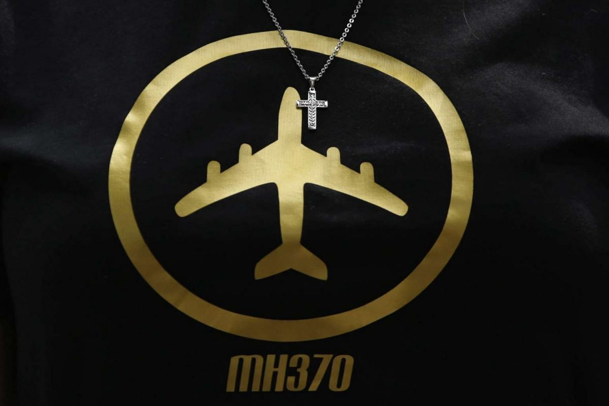 The daughter of MH370's in-flight supervisor Patrick Gomes wears a T-shirt with an illustration of the missing plane during a remembrance ceremony in Kuala Lumpur, Malaysia, on March 6, 2016.