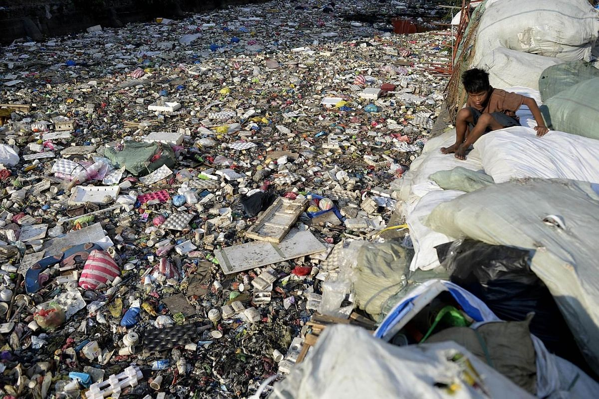 A river choked with plastic and other rubbish in Manila earlier this year. Plastic rubbish will outweigh fish in the oceans by 2050 unless the world takes drastic action to recycle the material, a report earlier this year warned. Plastic removed from