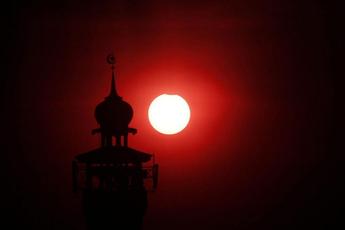 A partial solar eclipse is seen in Jakarta, Indonesia, on March 9, 2016.