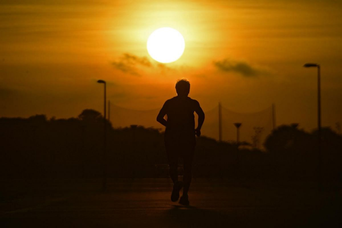 A jogger runs in the morning light before the solar eclipse on March 9, 2016.