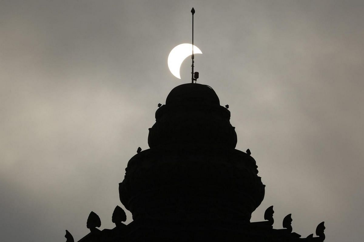 A partial solar eclipse is seen on the Independence monument in Phnom Penh, Cambodia, on March 9, 2016.