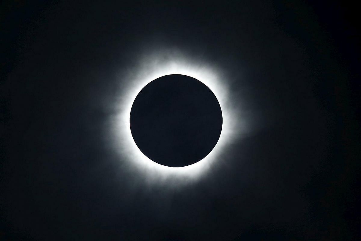 A total solar eclipse is seen from the beach of Ternate island, Indonesia, on March 9, 2016.
