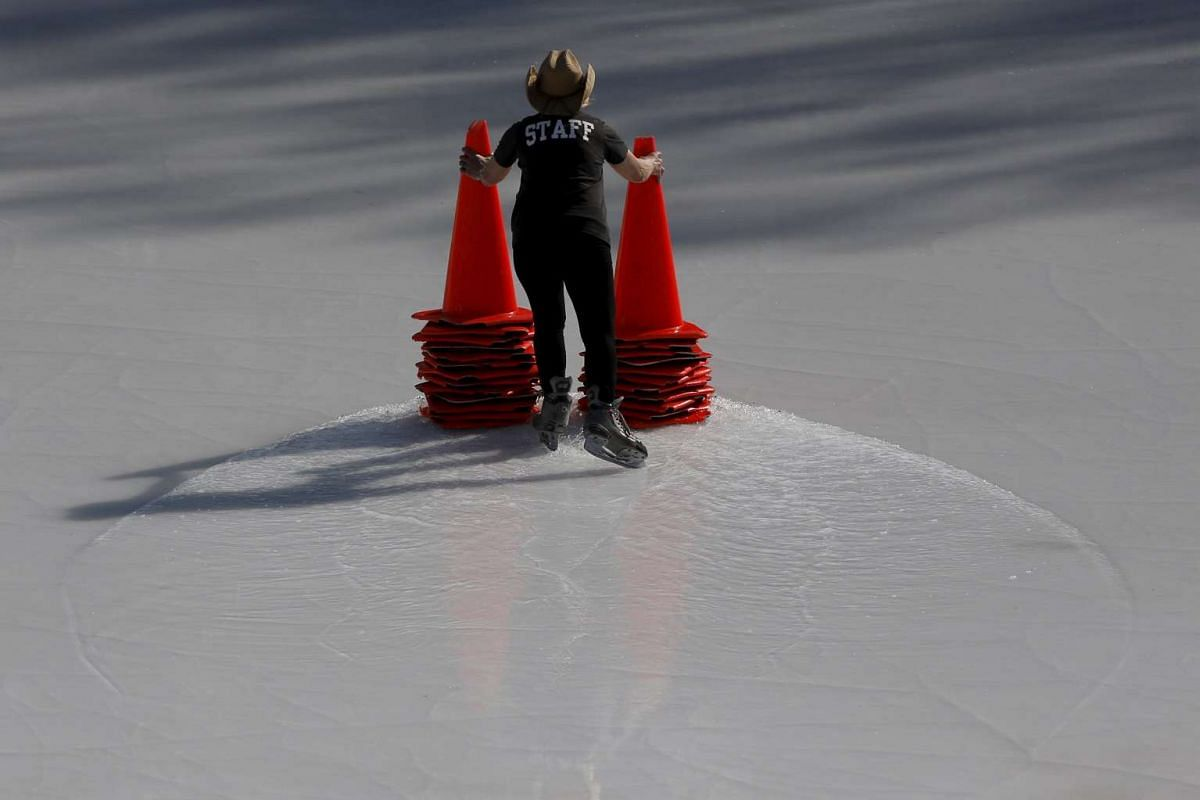 A female employee of Wollman Rink in Central Park skates with hazard cones in the Manhattan borough of New York on March 9, 2016.