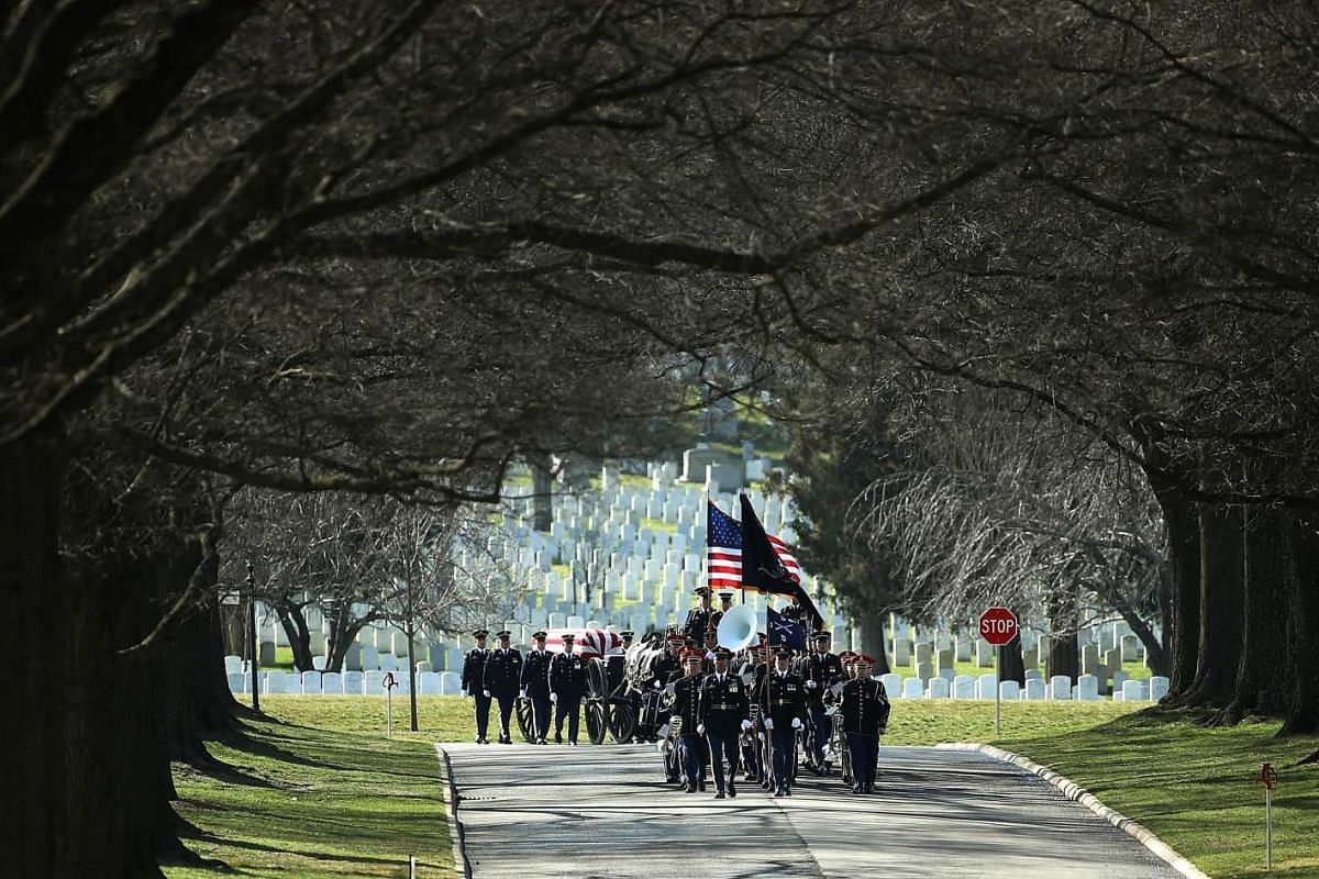 A US Army honour guard team escorts the casket of US Army Private First Class James M. Smith during the soldier's burial ceremony at the Arlington National Cemetery on March 9, 2016 in Arlington, Virginia.