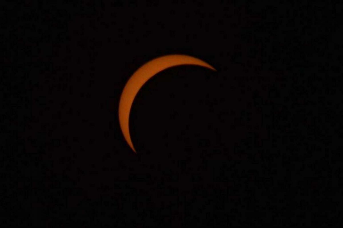 Student Dejoy Shastikk contributed this photo, taken when the maximum amount of the sun was covered by the moon.
