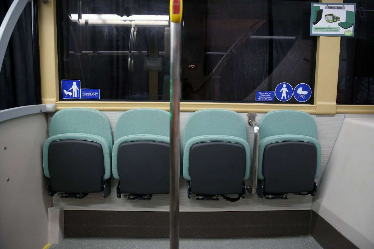 Foldable chairs onboard Bus B, which can be locked and unlocked by the driver.