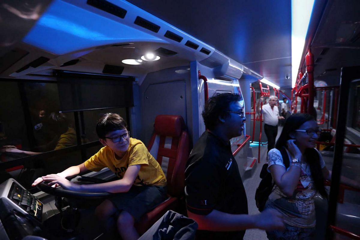 Visitors taking a look inside Bus A, one of the concept double-decker buses.