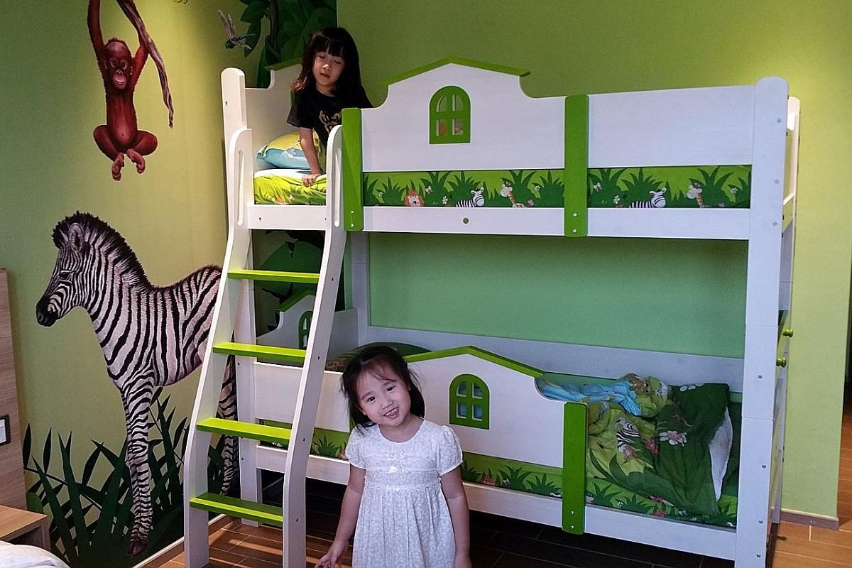 Ms Jade Wong and her husband have twice taken their daughters Katrina (left), seven, and Kassandra, four, for a staycation at D'Resort in Downtown East. Financial advisers Peter Sin and Cynthia Boon art-jamming during a staycation at The Quincy Hotel