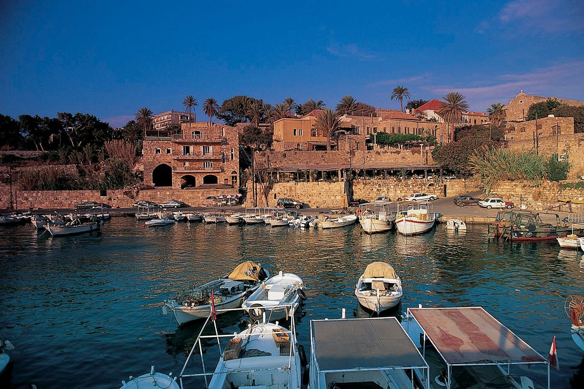 Fly Emirates to Lebanon, where travellers can linger in the Mediterranean harbour of Byblos (above). Or take Qatar Airways to Zanzibar, Tanzania, with its stunning beaches.