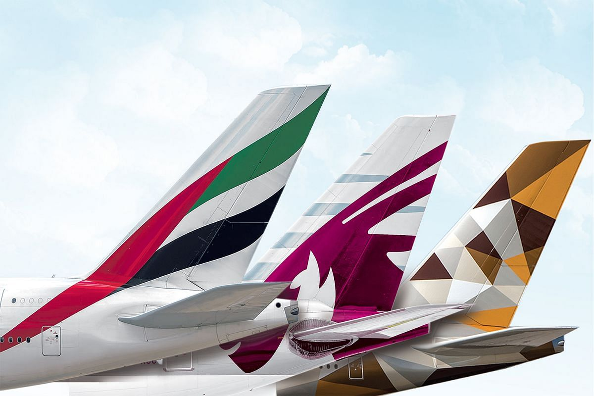 (From far left) Emirates, Qatar Airways and Etihad Airways have made their reputation on pampering customers.