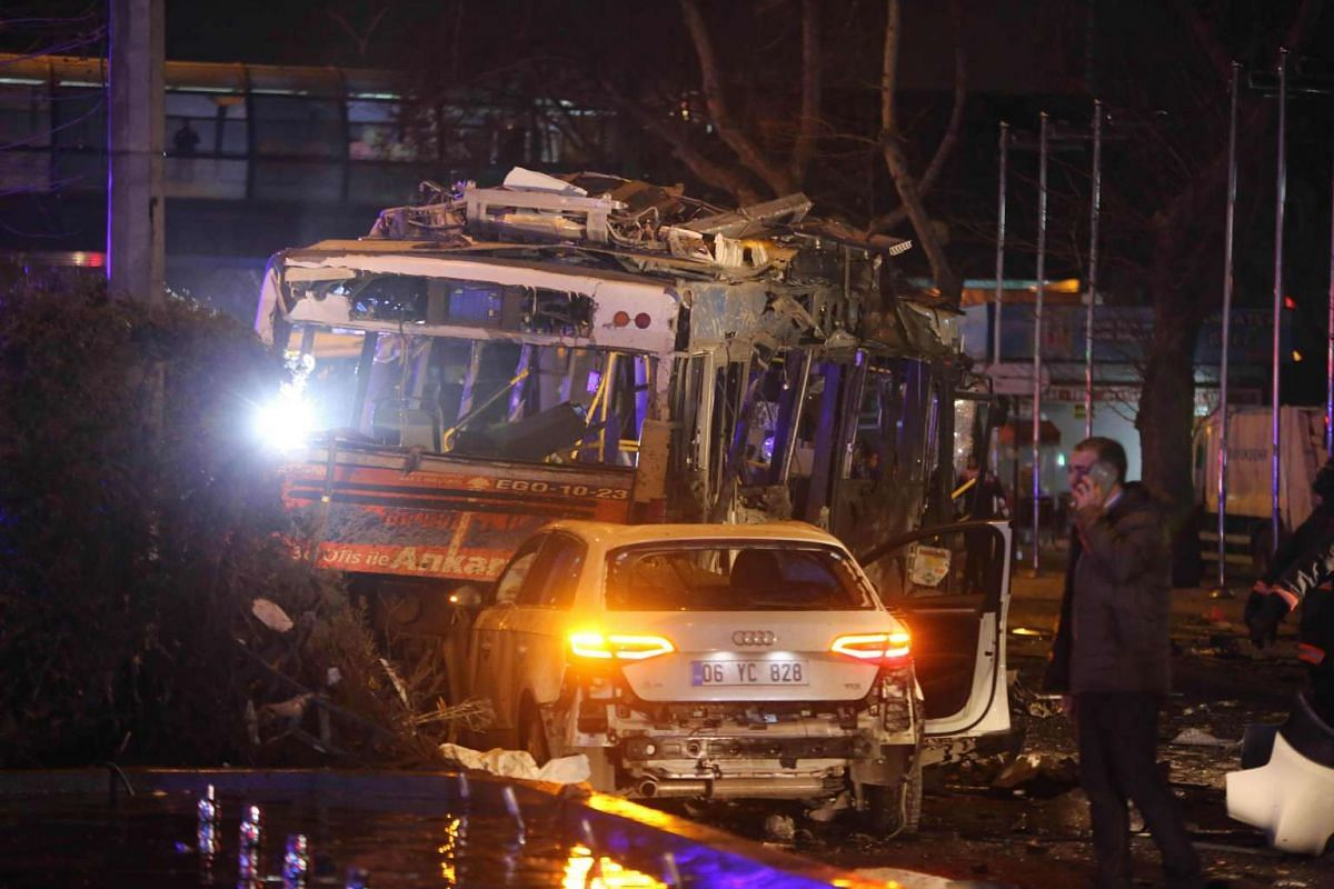 The wreckage of a bus and a car are pictured at the scene of a blast in Ankara on March 13, 2016. PHOTO: AFP