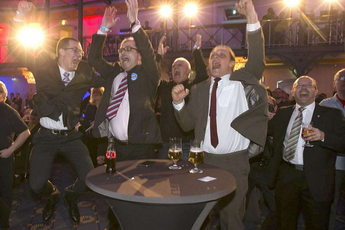 Supporters of anti-immigration Alternative for Germany (AFD) celebrate following first exit polls in the state election in Baden-Wuerttemberg in Stuttgart, Germany, March 13, 2016. PHOTO: REUTERS
